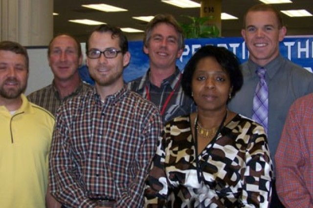 Vets honored, left to right: Eric Baker, Jacob Thoms, Joseph Taschler, Scott Esser, James Gahagan, Janette Colbert, Mitchell Driscoll, and John Moore.