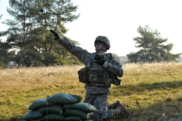 Capt. Troy Peterson, 2nd Cavalry Regiment, throws a training grenade during United States Army Europe's Best Junior Officer Competition in Grafenwoehr, Germany, Nov. 15, 2011. Peterson took first place in the competition.