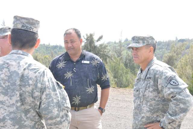 "KAHUKU, Hawaii "" Ken Torre (center), the training support manager for the Range Control Division "" Hawaii, and Col. Christopher Vanek (right), the brigade commander for the 2nd Brigade Combat Team, 25th Infantry Division, discuss the logistics of training with members of the 2nd BCT staff during a range reconnaissance at the Combined Arms Collective Training Facility in Kahuku, Hawaii on Nov. 9. The reconnaissance gave brigade leaders an opportunity to view a new training resource available as the brigade prepares to enter its next training cycle."