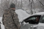 Guard Soldiers rescue motorist stranded in snow