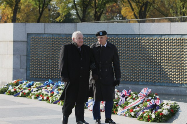 Pvt. Tyler Schwoob escorts Sir Stanley A. Wojtusik during the ceremony. About 110 advanced individual training Soldiers from the Ordnance School at Fort Lee spent Veterans Day at the National World War II Memorial in Washington, D.C., paying tribute to those who served in past wars.
