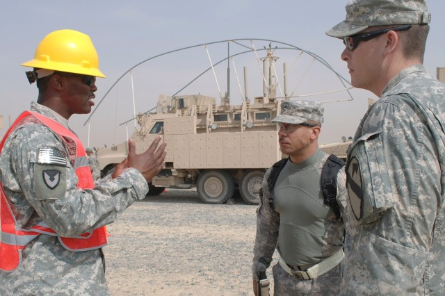Staff Sgt. Kwame Peterkin, noncommissioned officer-in-charge, Redistribution Property Assistance Team, 402nd Army Field Support Brigade, explains the turn-in process to incoming units at Camp Virginia, Kuwait.