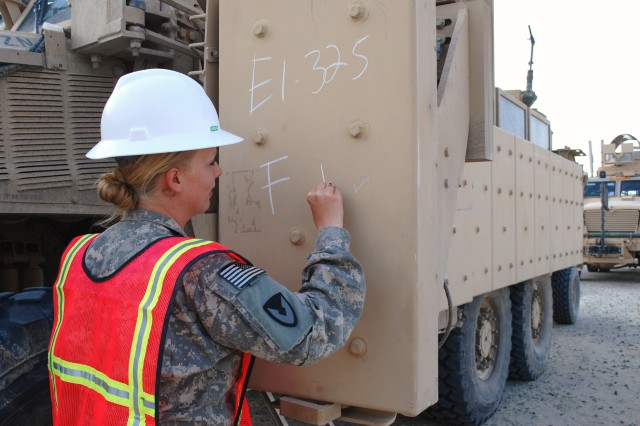 Pfc. Sarah Cervantes, 541st Combat Sustainment Support Battalion, marks the disposition of a tactical vehicle that has been turned in at Camp Virginia, Kuwait.