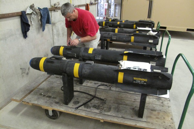 David Phillips, performs checks and services on a HELLFIRE missile that has been turned in to the Forward Test and Repair Faciltity in Qatar as part of the drawdown in Iraq.
