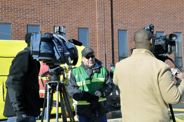 Lead exercise planner John Nuzback, who is from the Schenectady County Emergency Management Office, takes a moment to engage the local media. The Watervliet Arsenal hosted emergency first responders from four New York counties in the largest exercise of this type in the New York Capital District.