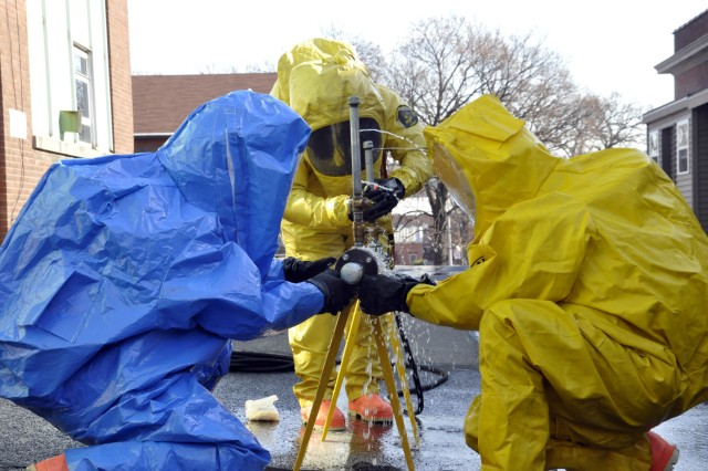 HAZMAT crews from two regional response teams attempt to stop a leak to a simulated acid pipeline. The Watervliet Arsenal hosted emergency first responders from four New York counties in the largest exercise of this type in the New York Capital District.