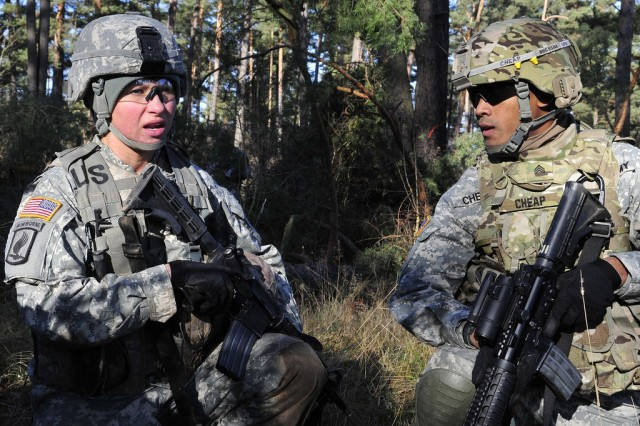1st Lt. Emille Prosko, representing the 173rd Airborne Brigade Combat Team gives instructions to Sgt. Cheap of the 172nd Infantry Brigade, who is acting as one of her team leaders, during the react to indirect fire lane at the U.S. Army Europe Best Junior Officer Competition on November 15, 2011. Company-grade officers from units through the US Army in Europe compete in the first annual Best Junior Officer Competition at the Joint Multinational Training Command which is the U.S. Army's only forward-deployed training command. The grueling three-day event challenged USAREUR's best officers on warrior tasks and drills, decision making, problem solving and leadership skills.  (U.S. Army photo by Master Sgt. Robert Hyatt)