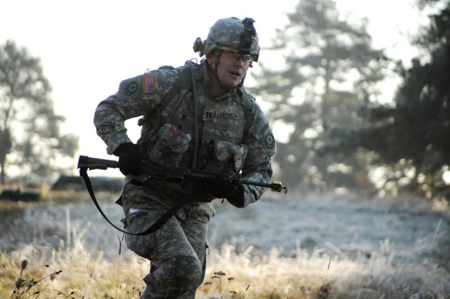 "Capt. Thomas Lorenson, 2nd Cavalry Regiment, heads forward to the next task during the United States Army Europe's Best Junior Officer Competition Nov. 15, 2011 at the Grafenwoehr Training Area. The competition is the first of its kind in Europe and gives company-grade officers the chance to compete in multiple tasks and be named ""Best Officer"" for U.S. Army Europe. The goal of the competition is to help leaders keep their skills up-to-date and their minds sharp. (U.S.Army Photo by Gertrud Zach)"