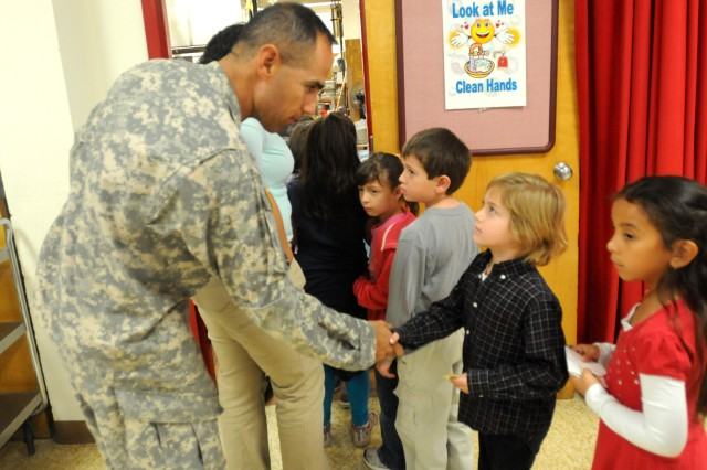U.S. Army Staff Sgt. Juan Valdez greets a young student as they arrive for lunch Nov. 16 at Polk Elementary School in El Paso. The Soldiers were there with the Fort Bliss Partnerships in Education Program.