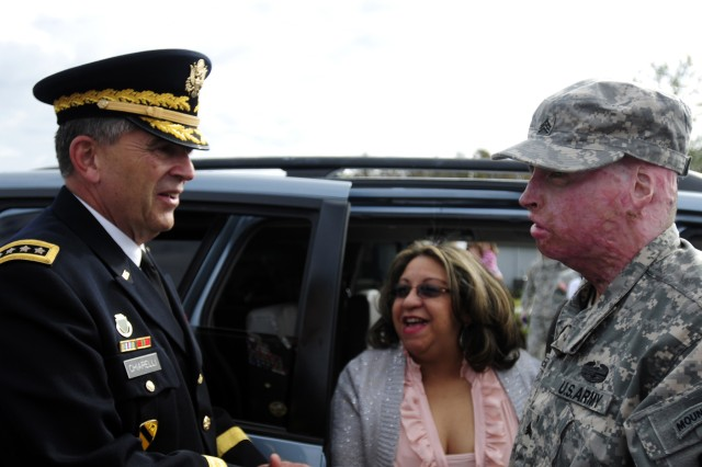 Vice Chief of Staff of the Army Gen. Peter Chiarelli greets Sgt. Joel Tavera as he makes his way to his new home provided by Building Homes for Heroes, Nov. 19, 2011.