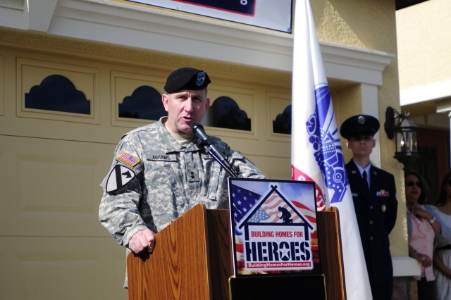 "Third Infantry Division Commander Maj. Gen. Robert ""Abe"" Abrams speaks during Sgt. Joel Tavera's homecoming, Nov. 19, 2011."