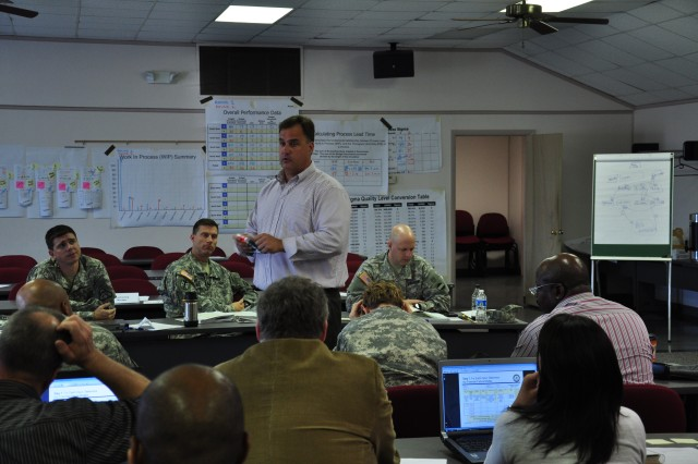 FORT BRAGG, N.C. (Nov. 16, 2011) -- Steve Sawicki, U.S. Army Forces Command (FORSCOM) Business and Readiness Improvement Division process improvement specialist and Lean Six Sigma Master Black Belt discusses how to quantitatively analyze data in a simulated business process during the Army Lean Six Sigma Green Belt Course taught here, Nov. 14-18, 2011.   U.S. Army photo by Bob Harrison, FORSCOM Public Affairs.
