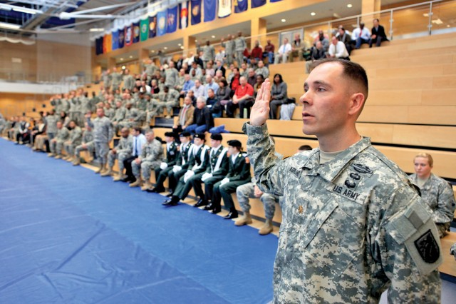 Maj. David Kirkland, 5th Signal Command, recites the oath of office for officers during the Operation Solemn Promise event at the Wiesbaden Fitness Center Nov. 17.