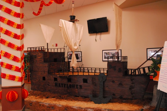 A replica of the Mayflower sits inside the Drill Sergeant School dining facility during last week's Thanksgiving meal. Alongside the ship were placards that listed the actual ship's floorplan and other historical facts, such as information about the crew.