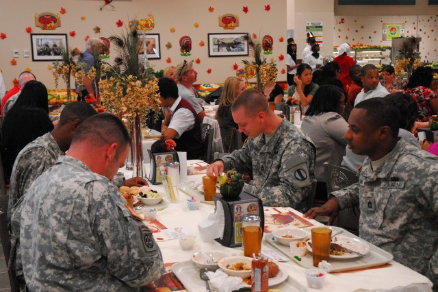 A group of civilians and Soldiers eat an early Thanksgiving meal in the intricately decorated Drill Sergeant School dining facility Wednesday. The DSS dining facility staff is hoping to win the annual postwide dining facility competition, which they won last year. The DSS was the first to be judged in this year's competition.