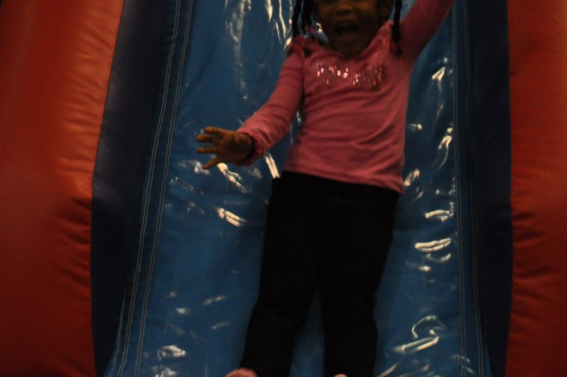 Kelis Ransom, 4, squeals while coming down the slide of a bounce house during Saturday's Family Fun Fair.