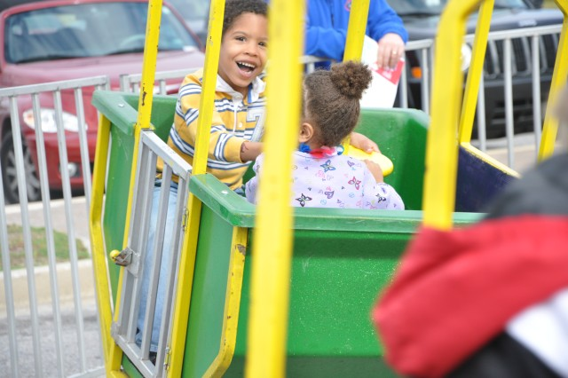 Jaylen Sepulveda,5, is all smiles as he swings with his sister, Alexia,3, at Saturday's Family Fun Fair at the Solomon Center.