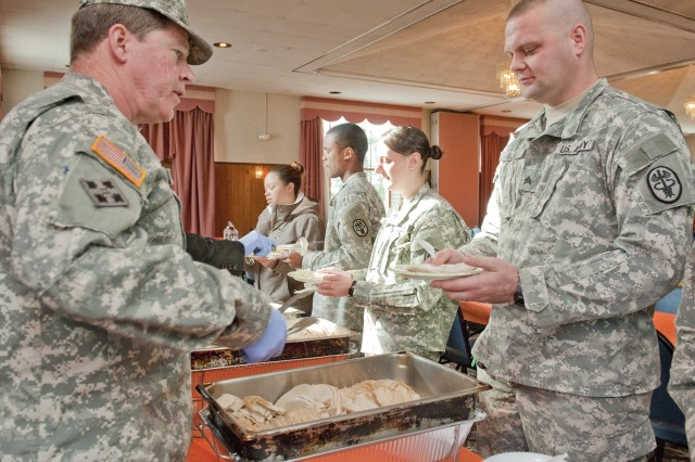Brig. Gen. John J. McGuiness, left, senior commander of Natick Soldier Systems Center, serves Soldiers Nov. 18 at NSSC's annual Thanksgiving Luncheon.