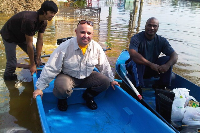 Maj. Paul Watkins (left) and Sgt. 1st class Corey Powell prepare to deliver supplies and assess flooding at the Rangsit Freezer Farm.