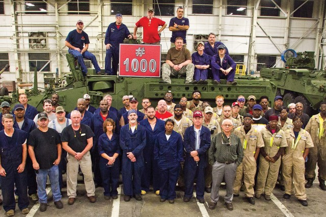 Anniston Army Depot, Ala., and General Dynamics Land Systems night shift employees gather around ICV-0059, the 1,000th Stryker reset at the depot. The public-private partnership between the two organizations is a unique relationship that ensures an increased workload and the necessary employees to accomplish the mission and bring every Stryker to a mission-ready level for the warfighters.