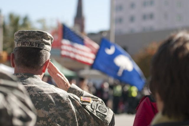 U.S. Army Col. Ken Royalty, chief of staff Fort Jackson, salutes during the rendering of the colors at the commencement ceremony for the Columbia, S.C., Veterans Day parade Nov. 11.