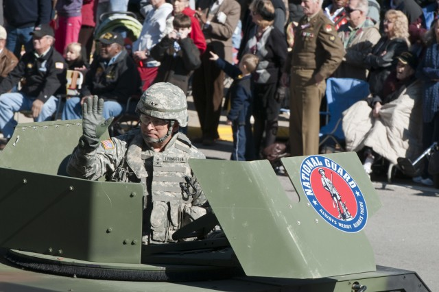 Maj. Gen. Robert E. Livingston Jr., adjutant general of South Carolina, waves at onlookers during the Columbia, S.C., Veterans Day parade Nov. 11. Livingston leads the parade through downtown Columbia as the parade marshal.