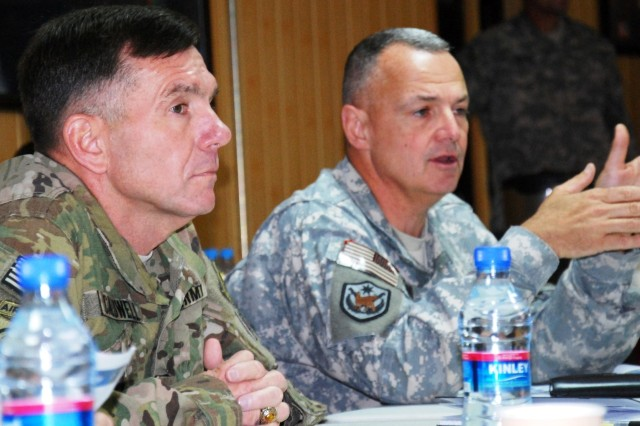 Lt. Gen. William B. Caldwell IV, then commanding general, NTM-A/CSTC-A, listens as Brig. Gen. Tom Cosentino comments during the opening remarks of the Regional Support Command Commanders Conference May 17. (Photo by Navy Petty Officer 2nd Class Vladimir Potapenko)