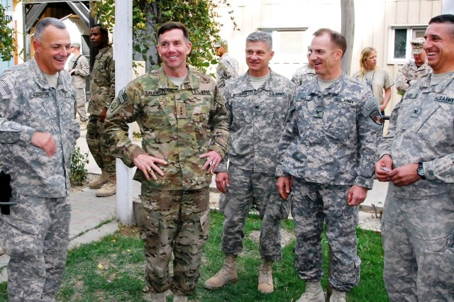 Lt. Gen. William B. Caldwell IV, then commanding general, NTM-A/CSTC-A, draws smiles from Brig. Gen. Tom Cosentino (left), DCOM-RS; Col. Ron Metternich, then RSC-East commander; Col. Greg Baine, then RSC-South commander; and Col. Paul Calbos, then RSC-North commander, after the completion of the Regional Support Command Commanders Conference May 19. (Photo by Jon Connor)