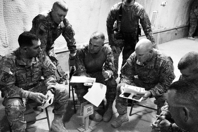 Brig. Gen. Tom Cosentino reviews plans for an upcoming air assault operation against insurgents in southern Afghanistan June 15. (Photo by Jon Connor)
