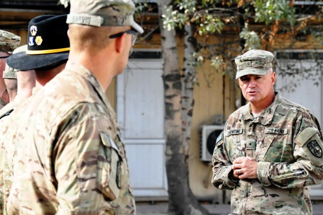 Brig. Gen. Tom Cosentino speaks prior to an awards ceremony to recognize the accomplishments of 3rd Battalion, 4th Infantry Regiment Soldiers whose home station is Baumholder, Germany, Oct. 29 at Camp Eggers, Kabul. (Photo by Jon Connor)