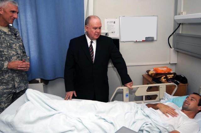 Under Secretary of the U.S. Army Joseph W. Westphal and USAREUR Commander Lt. Gen. Mark P. Hertling visit a wounded warrior at the Landstuhl Regional Medical Center in Landstuhl, Germany.