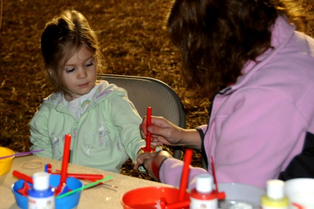 A child gets a butterfly stamped on her hand at the Night Under the Stars event. Face painting was one of many children's events provided at the all-night campout on the shore of Lake Tholocco Nov. 19.