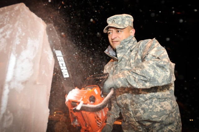Sgt. 1st Class Richard Schott, a food service NCO at Fort Riley's Demon Diner, uses a chain saw to carve an ice sculpture Nov. 22 for a Thanksgiving meal.