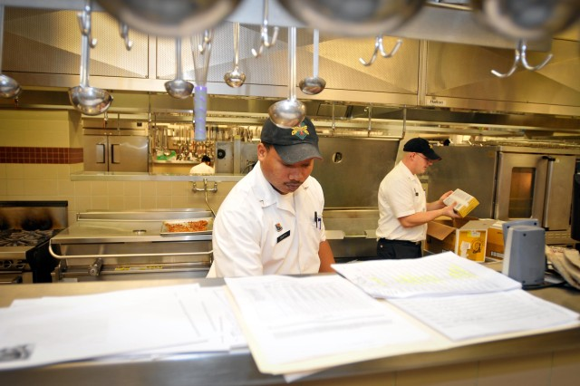 Army cooks at Fort Riley's Demon Diner dining facility manned the kitchen around the clock Nov. 22 to prepare for their Nov. 23 Thanksgiving meal service.