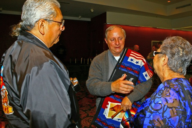 Towana Spivey (center), Fort Sill National Historic Museum director and curator, talks with guests after the installation's National American Indian Heritage Month luncheon Nov. 17 at the Patriot Club. Spivey was the guest speaker and spoke about his upbringing in Oklahoma, and American Indians serving in the U.S. military.