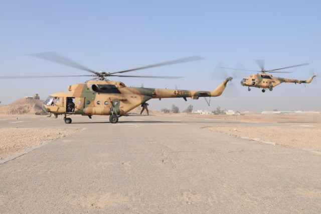 Two MI-17 Iraqi helicopters made their way over the city of Ramadi, Iraq, and the Euphrates River to land at the helicopter-landing zone on Camp Ramadi, Nov. 15, 2011.