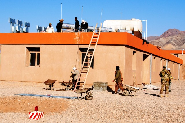 Local Afghans continue work on the 4th Zone Afghan Border Patrol compound adobe-style dining facility Oct. 14, 2011, in western Afghanistan.