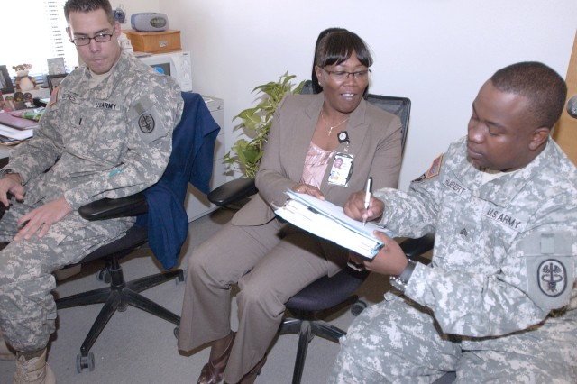 Warrior Transition Brigade's nursing case manager orientation and pre-ceptorship program ensures consistency and promotes quality care for Soldiers assigned to the WTB.  WTB nurses, according to Peggy Thomas (center) have a unique mission, unlike anything else in the Army. Training lasts about two months, including 40 hours of online training specific to WTB documentation and care plans. With Thomas are 1st Lt. Frank Deffes and Private 1st. Class Gene Hubert.