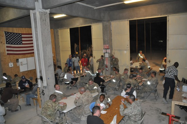 Forward Operating Base Farah held a spades tournament as part of their Thanksgiving Day celebrations.  The tournament, which was held in the motor pool, lasted four and half hours and had nearly 50 participants.