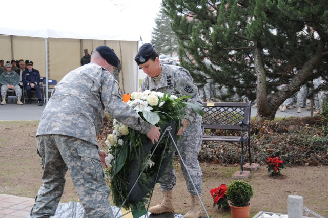 Col. Brian Bisacre, the commander of the 18th Military Police Brigade along with Command Sgt. Maj. Brenda Curfman, the senior enlisted advisor of the 18th MP Bde., place a wreath in front of the memorial dedicated to the fallen Soldiers of the 18th MP Bde. on Sembach Kaserne, Germany, Nov.17.