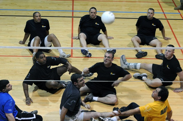 The Army team in black and the Pentagon team go head-to-head at the sitting volleyball tournament sponsored by the Warrior Transition Command Nov. 22, 2011.