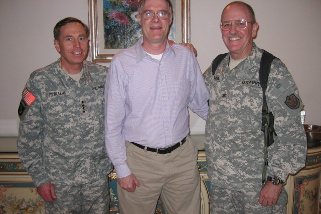 The lead author of FM 3-24 was Dr. Conrad Crane,(Center) here photographed with GEN David Petraeus (L) in Baghdad in November 2007. The other person is COL John Martin, (R) who  also contributed to the writing effort. All three are West Point classmates. (Author's Collection).