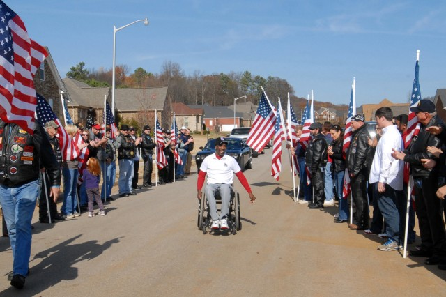 As Jeffery Williams arrives, Patriot Guard riders line his pathway to the ceremonial sight on the lawn of his new home.
