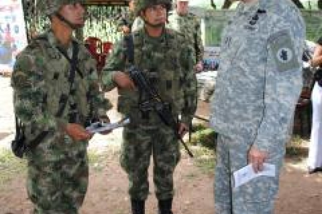Maj. Gen. Simeon G. Trombitas (right), U.S. Army South commander, discusses human rights and ethics training with Colombian soldiers at Tolemaida, Colombia, March 23, 2011.