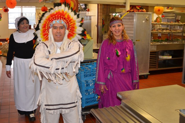 Staff from the McGregor Range dining facility dressed in historical costumes pose for a photo after serving a traditional Thanksgiving lunch to Army Reserve Soldiers preparing for deployments.