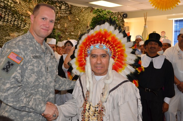 Command Sgt. Maj. Michael Schultz, US Army Reserve Command, meets with the dining facility staff after a Thanksgiving lunch at McGregor Range, New Mexico.  The staff decorated the facility and dressed in historic costumes to lift the spirits of the Soldiers preparing for deployment.