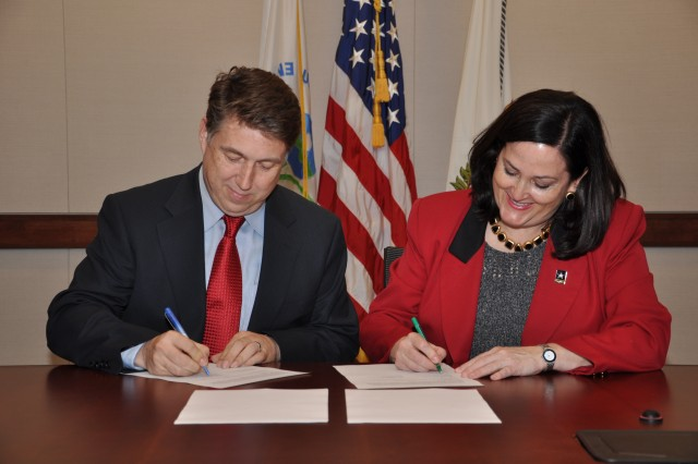 Dr. Paul Anastas and HON Katherine Hammack sign a memorandum of understanding at EPA Washington D.C. Headquarters. The U.S. Army and the Environment Protection Agency are enhancing working relationships starting with a joint collaboration on the Army's Net Zero initiative and related activities on U.S. Army Installations.