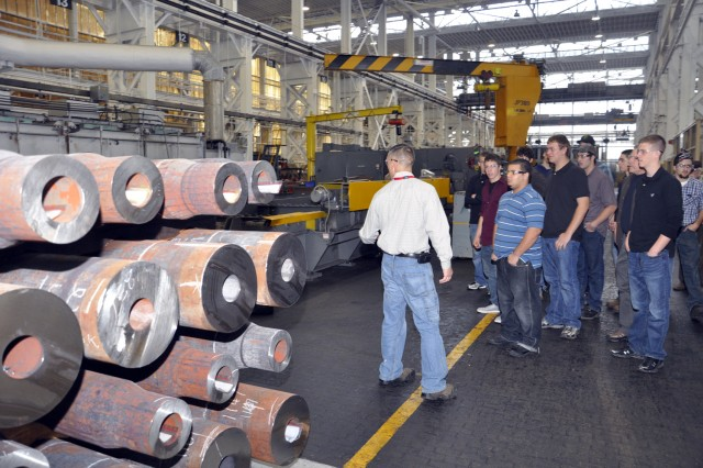 Arsenal Apprentice Program Supervisor John Zayhowski, explains the manufacturing process of large caliber tubes at Watervliet Arsenal, N.Y., to Sullivan County high school students.