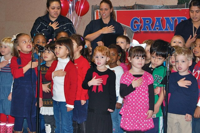 """Children from the Camp Humphreys Child Development Center's Strong Beginnings classes, recite the Pledge of Allegiance during the Grand Opening ceremony for the Super Park, Nov. 30. """" U.S. Army photo by Steven Hoover"""