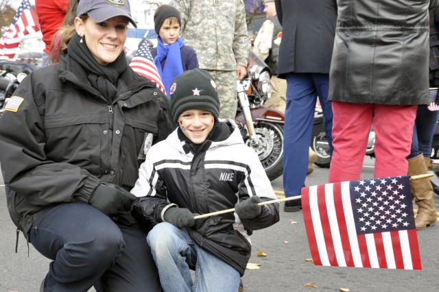 Arsenal Security Officer Laurie Moffre with her son get ready to lead the parade.